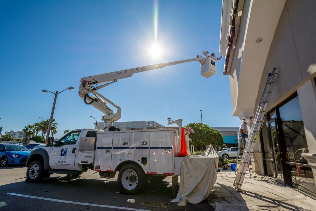 a bucket truck being used for painting